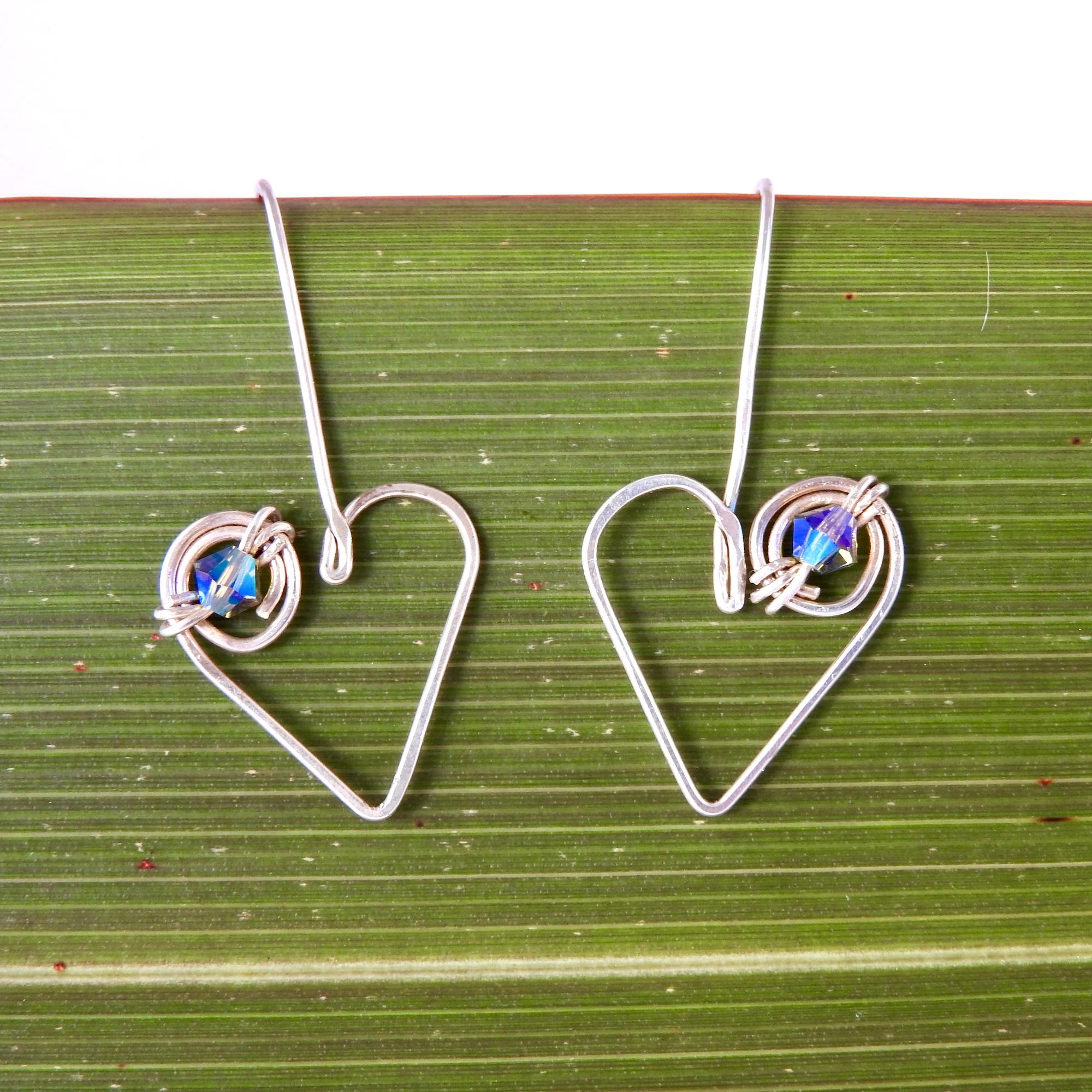 Koru Heart Dangle Earrings with Swarovski Crystals front on flax