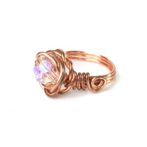 Side view of large crystal rose ring in copper wire