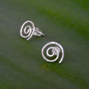 Close up of NZ Maori Koru Spiral Stud Earrings showing texture and catch the light