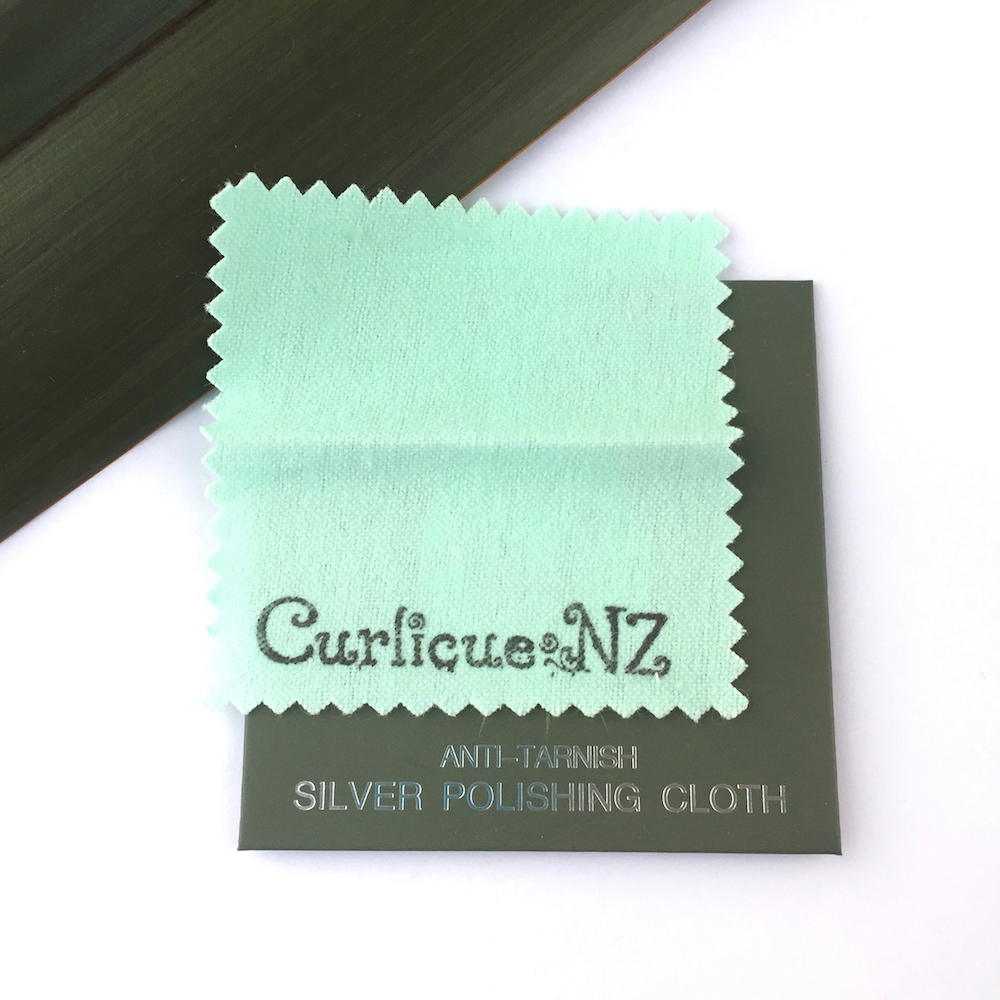 care and cleaning_ a Curlicue NZ anti tarnish silver polishing cloth
