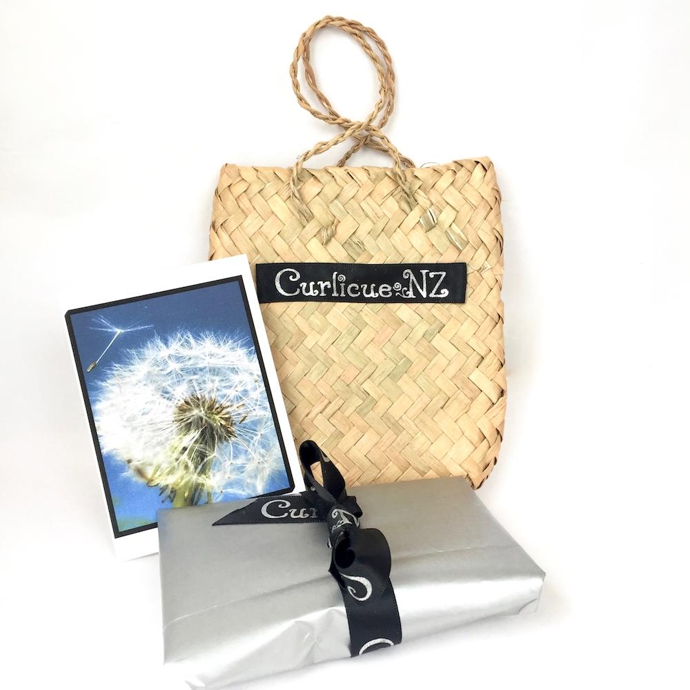 Woven flax kete bag premium gift wrap with handmade dandelion card