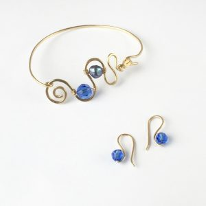 Blue Pearl & Crystal set in gold plated wire
