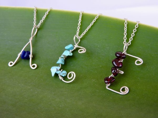 Initial letter necklaces capital A C E with semi precious stones attached