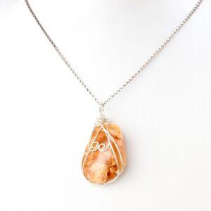 Clover Honey coloured NZ kauri resin silver double koru necklace