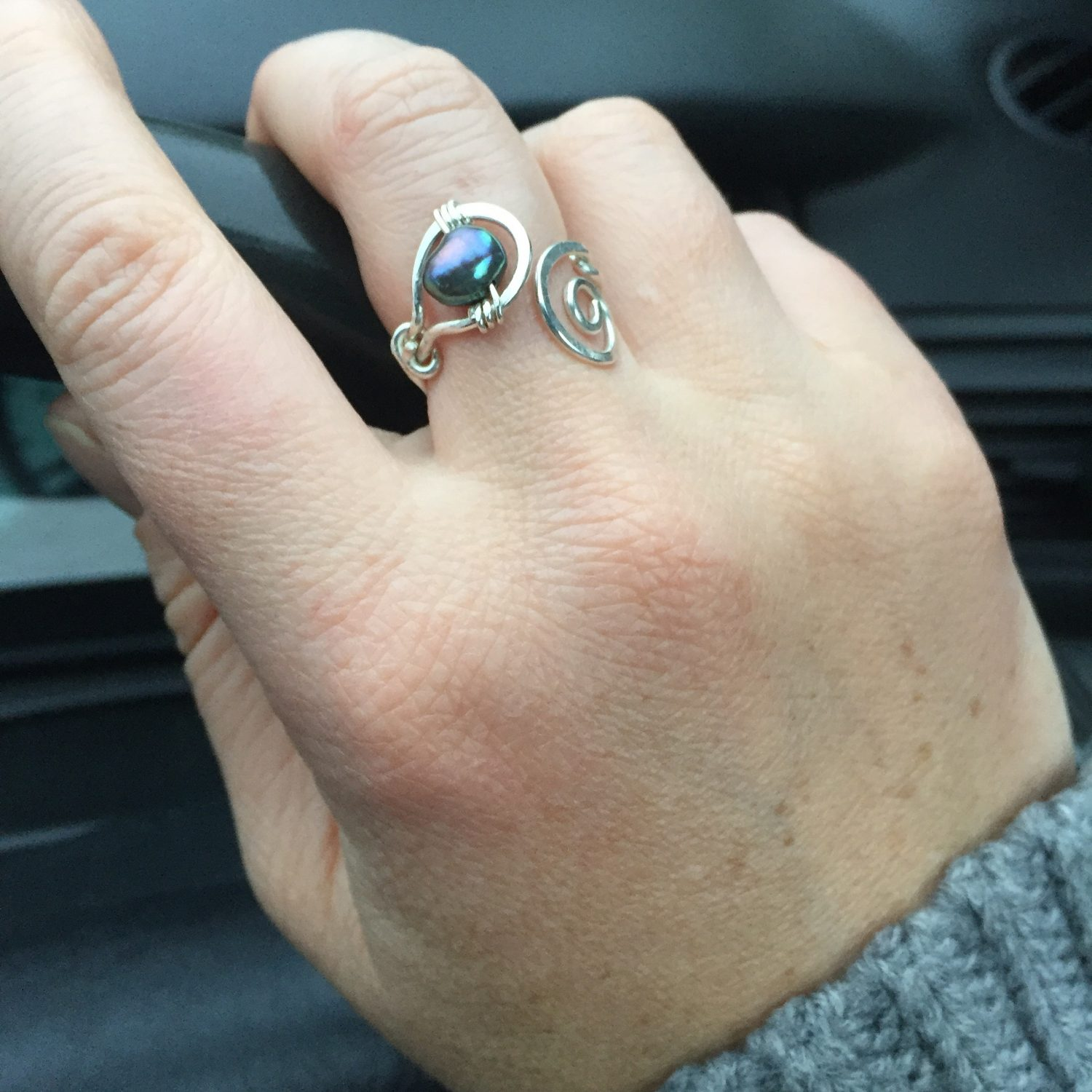 Wearing the Pearl and Spiral Koru Ring while out and about