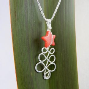 side angle view of Xmas necklace with red mother of pearl star