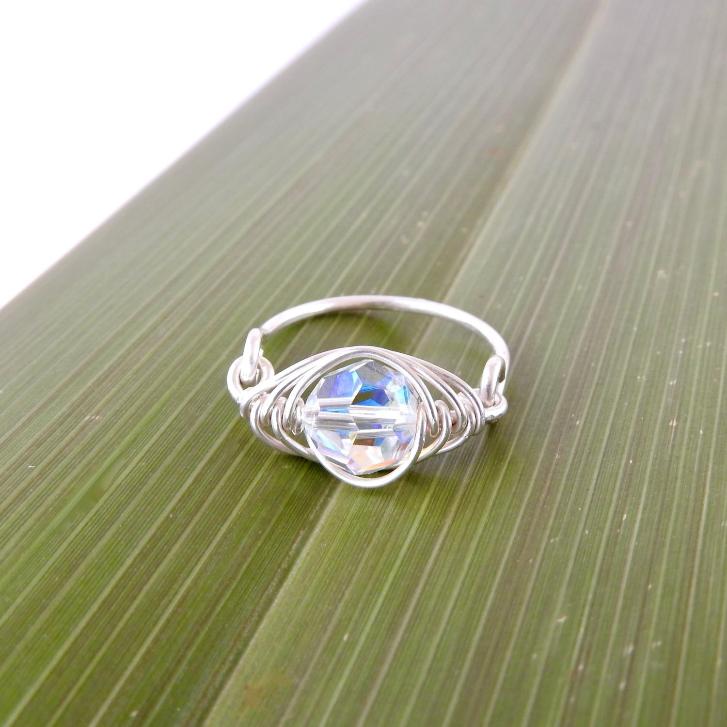 Iridescent Clear AB Swarovski Crystal used as April birthstone 'diamond' in this handmade birthstone ring in eco silver