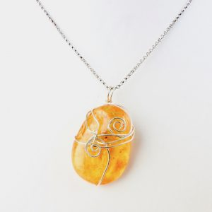 Transluscent Honey Kauri Resin Necklace with 2 koru in eco Silver