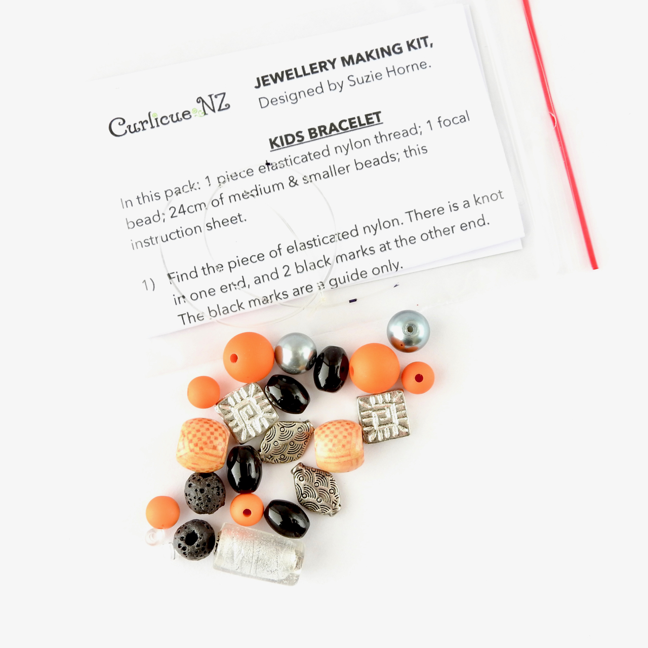 Unisex kids bracelet making kit in orange, silver and black