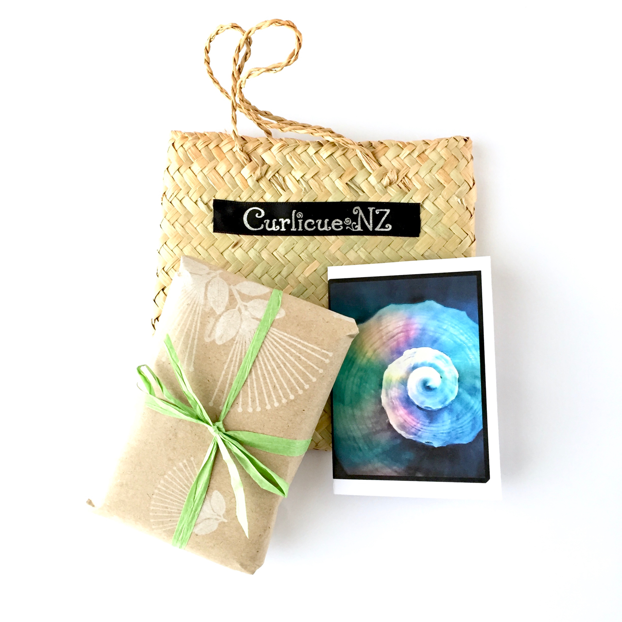 Flax Kete with Kraft paper wrapped jewellery and Rainbow Shell Card