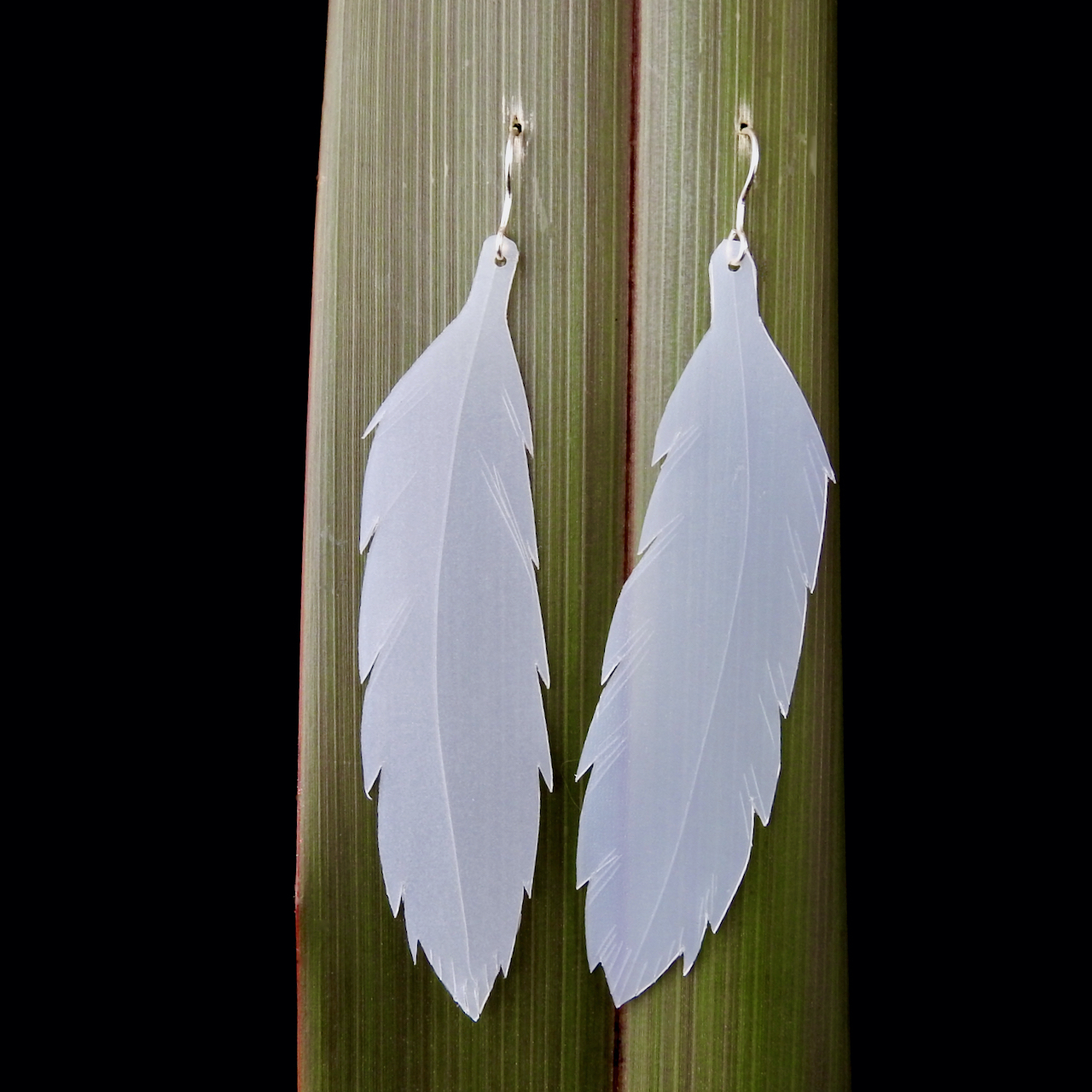 Large Feather Earrings handmade from plastic milk bottles and eco sterling silver hooks_hanging on flax