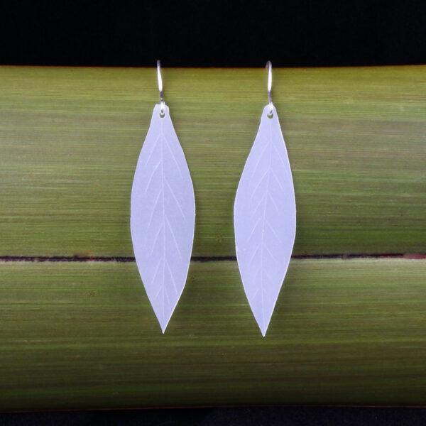 Leaf dangly earrings made from repurposed milk bottles