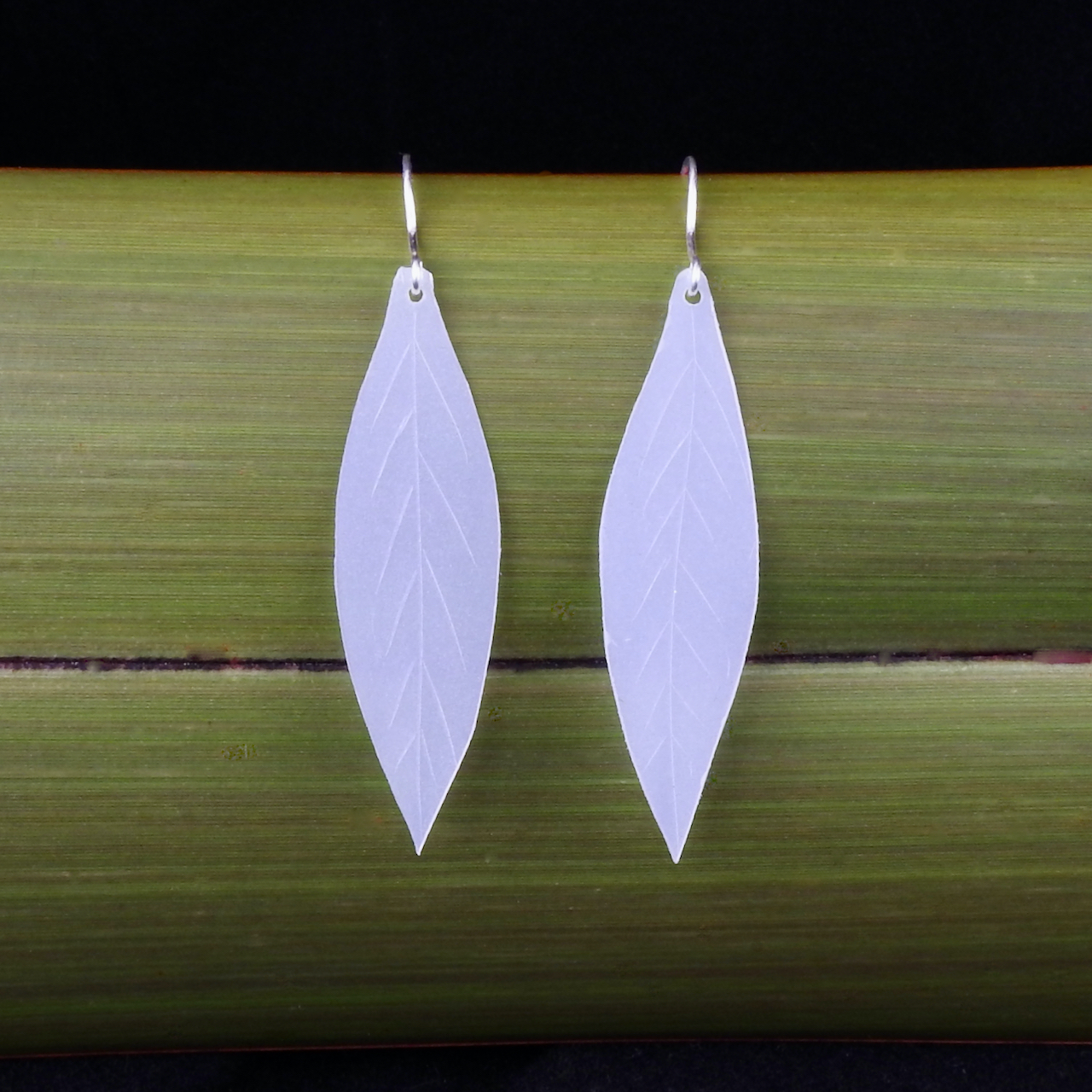 Leaf dangly earrings made from recycled milk bottles