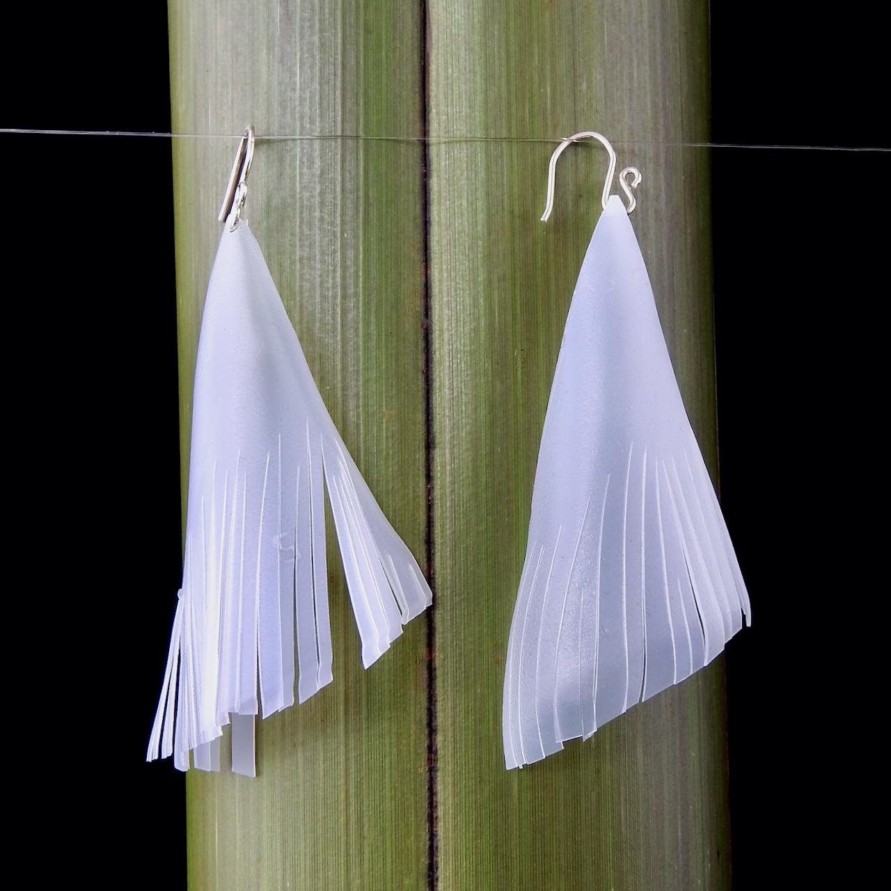 Long Tassel Earrings repurposed from milk bottles_Hanging against flax