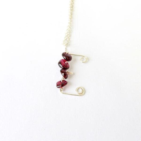 Kid sized capital letter E necklace with garnet semi precious stones