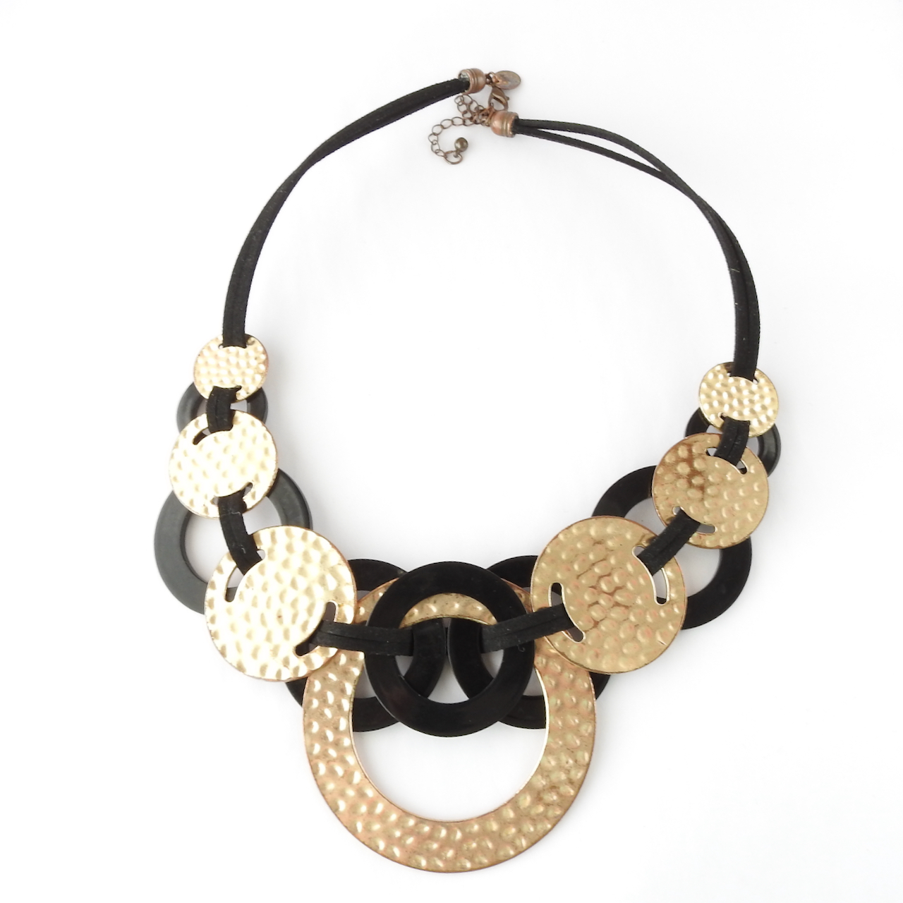 Back of black and gold circle necklace