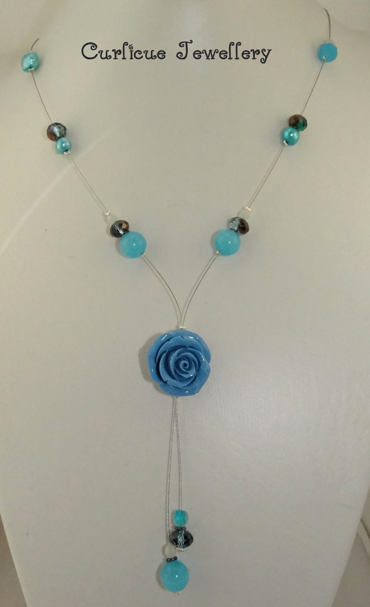Repaired blue flower beaded necklace