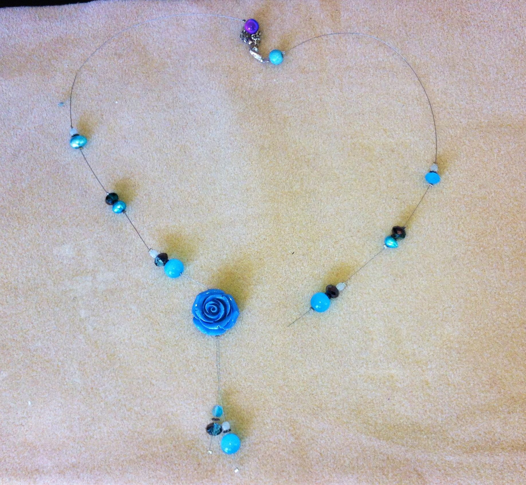 Broken Blue Flower Bead Tigertail necklace